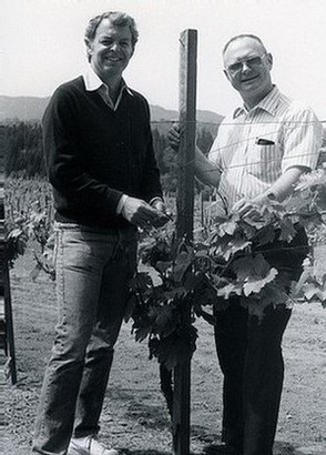 Black and white image of Bill Malkmus and Winemaker Bill Fuller standing in the vines
