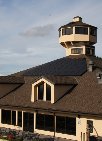 Solar panels on roof of tasting room with tower in background