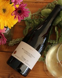 Vintage 44 Chardonnay with flowers and wine glass