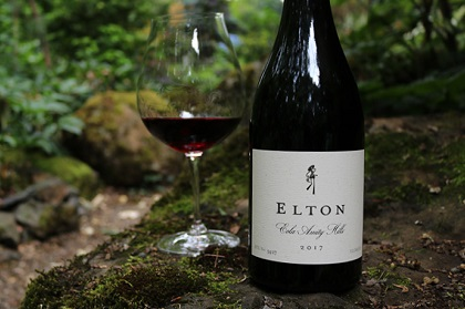 Shot of Elton Pinot Noir with full glass of wine in the garden