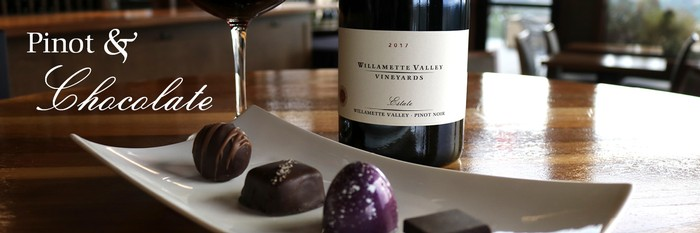 Pinot noir with assorted small chocolates on plate.