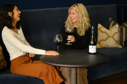 Two women in the tasting room enjoying wine