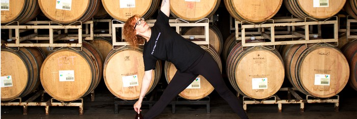Winery Ambassador Suzanne Zupancic doing yoga in the cellar