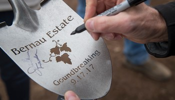 Jim Bernau signs shovel for Bernau Estate groundbreaking