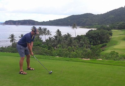 Spence golfing in a tropical place