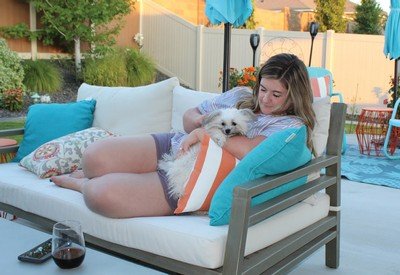 Employee Tayler relaxing with her dog Chief