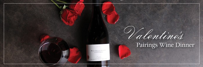 Photo of wine bottle with roses and rose petals