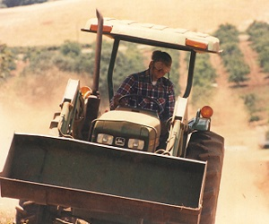 Jim Bernau clearing the land in the early 1980s