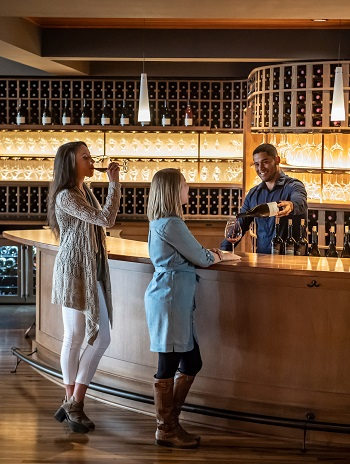 Enjoy our classic Oregon wines and breathtaking vineyard! Pictured: Guests enjoying wine at the Estate Tasting Room.