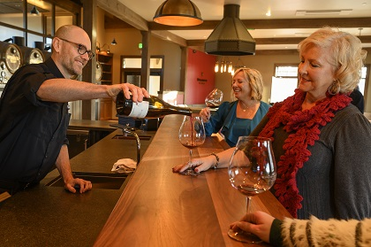 Pouring wine from the bar at Willamette Wineworks