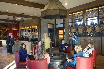 group gathered around the fireplace with wine at Willamette Wineworks